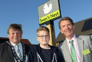 Cllr Colin Houghton Elliot Clark and Tony Abel in front of the new village sign at Swans Nest in Swaffham sm