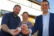 Jonathan Beedell left and Katja Galea receive their keys from Abel Homes managing director Paul LeGrice sm