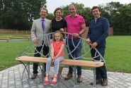 Phil and Bonnie Royle and their daughter Grace unveil the new bench watched by Tony Abel left and James Spedding right sm