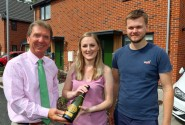 Tony Abel left of Abel Homes with Sian Smith and Alex Williams outside their new home in Swaffham sm