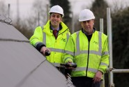 Paul Legrice left and Alan Read of Abel Homes perform the traditional topping out ceremony at Little Melton sm