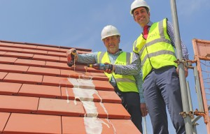 Alan Read left and Paul LeGrice top out the showhome at Hares Green in Watton sm