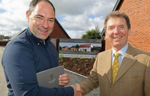 Housebuyer Phil Royle left is congratulated by Tony Abel on being the first to buy a new home at The Limes in Little Melton sm