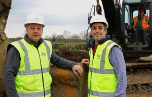 Robert Loudoun left and Paul LeGrice of Abel Homes dig the first sod at the site of 40 new homes in Bawdeswell sm